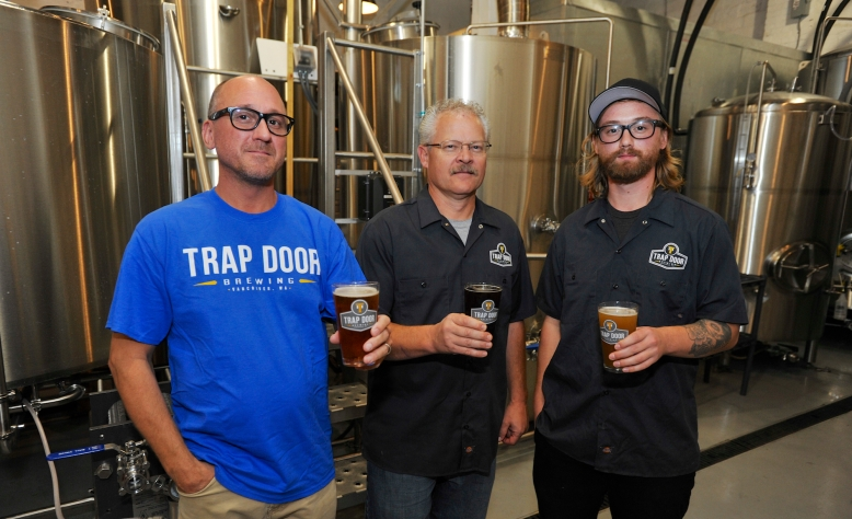Co-owners Bryan Shull, Dave Forster and Zane Singleton at the Grand Opening of 'Trap Door Brewing' in Vancouver, Wa., Saturday Oct 24, 2015. (Greg Wahl-Stephens for the Columbian)